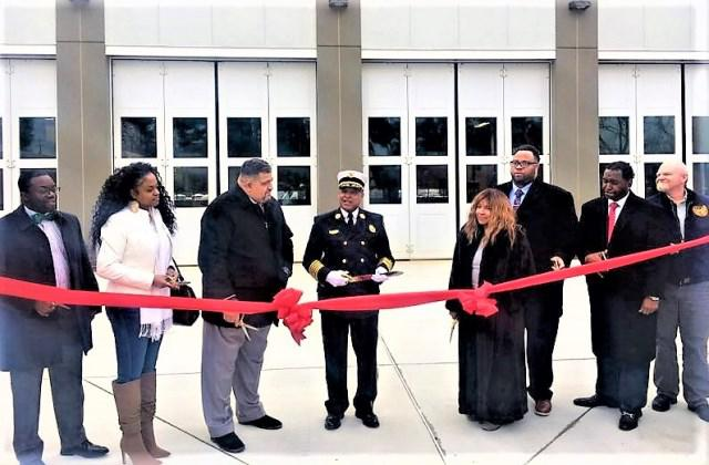 Public Safety Director Kinamo Loman, Deputy Mayor Rebecca Perrone, Mayor Martin Nock, Chief of Department Anthony Burnett, Councilwoman Jacqeuline Jennings, Councilman Darvis Holley,  Councilman Nathaniel Anderson,  and Deputy Township Manager Rich Brevogel prepare to cut the ribbon
